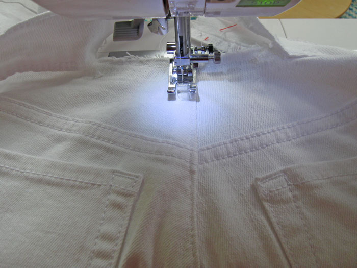 Redo topstitching at center back