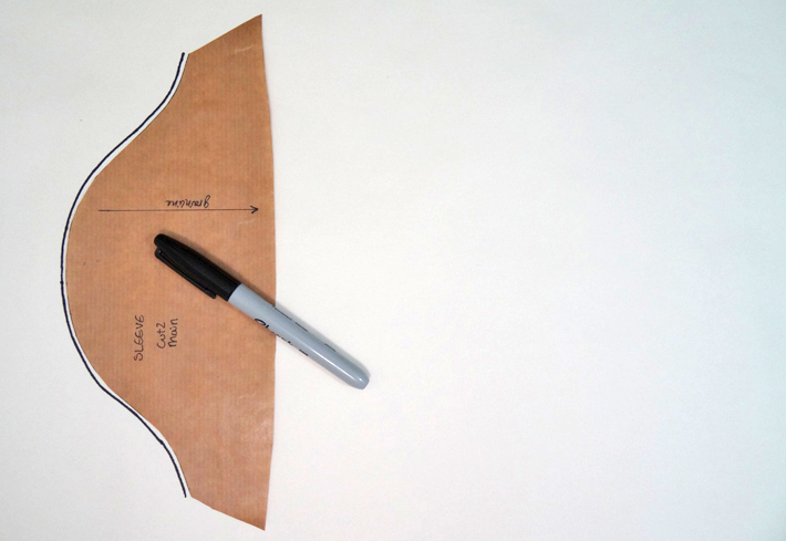 Trace the curved shoulder edge of the pattern