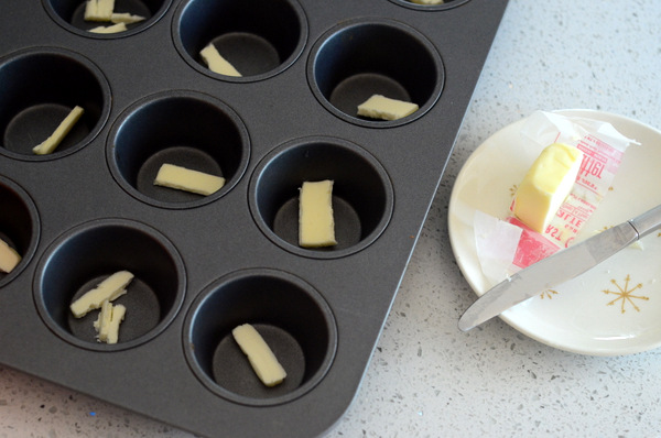 Buttering a Muffin Pan for Pancake Cups