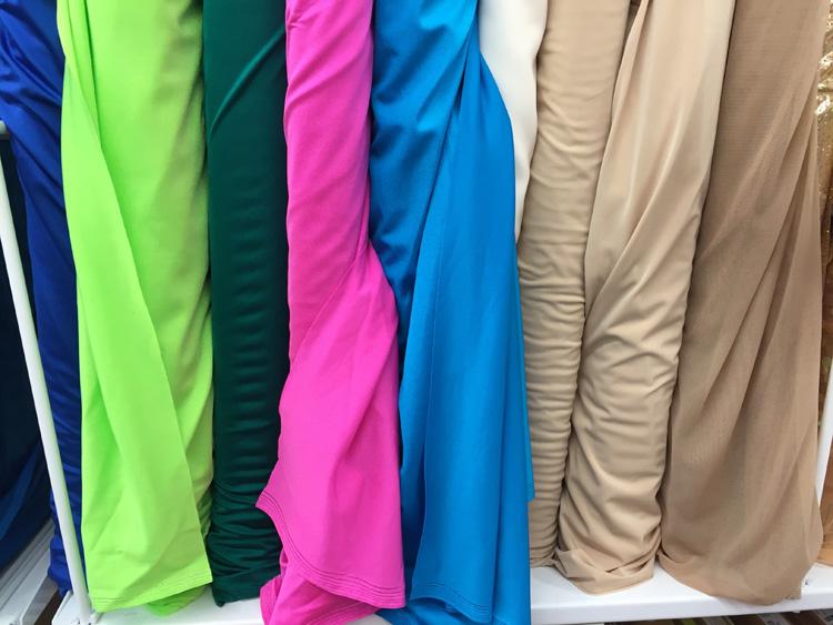 swimsuit fabrics on rack