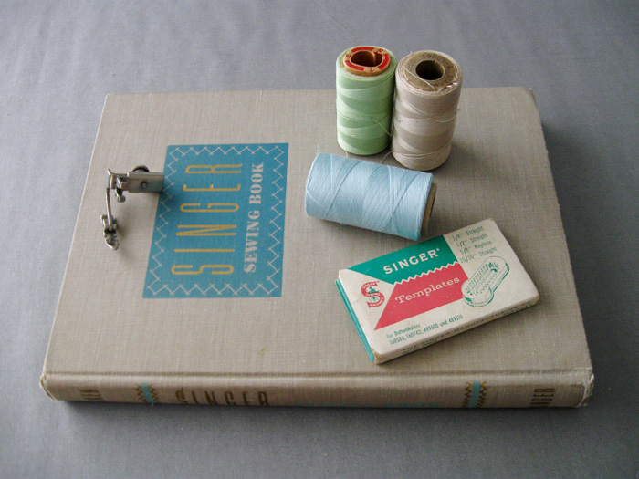 sewing supplies and book