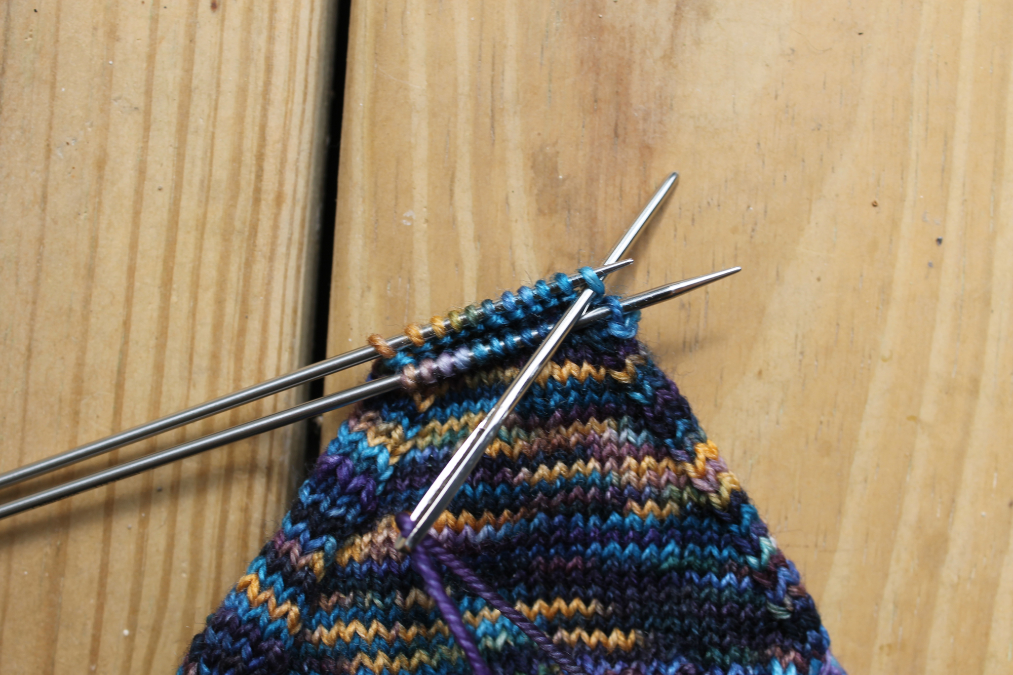 Inserting the needle knitwise on the back needle