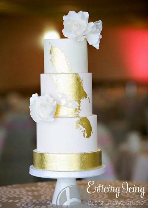 Modern white and gold wedding cake by Enticing Icing