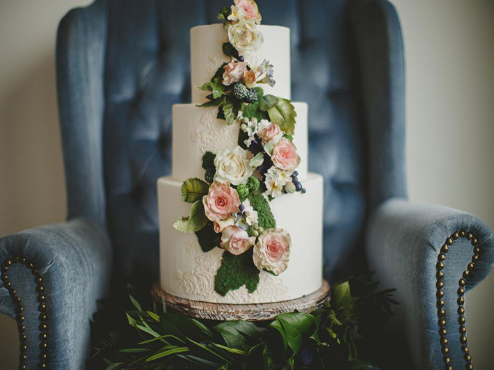 Floral adorned white wedding cake