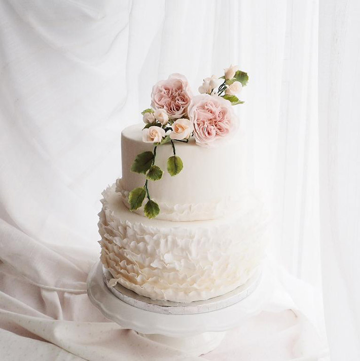 Pretty fondant ruffled wedding cake