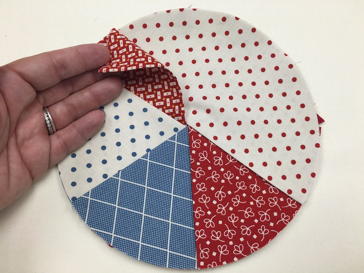 layer and tuck the fifth pressed circle