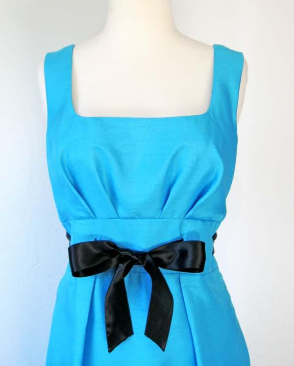ribbon sash on blue dress