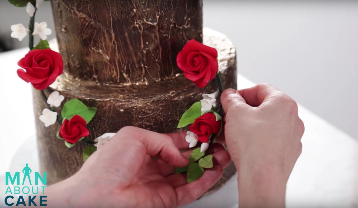 Creating a sugar flower wreath on a cake