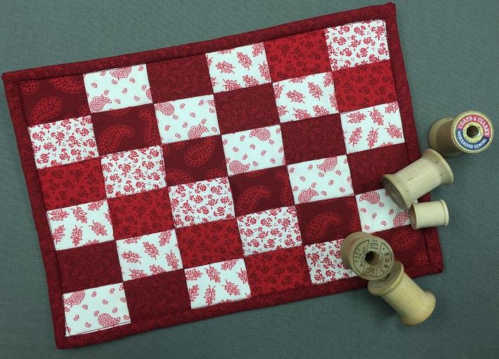 august checkerboard mug rug
