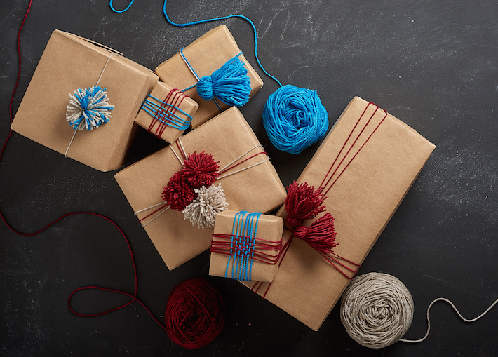 Gifts wrapped with yarn decorations