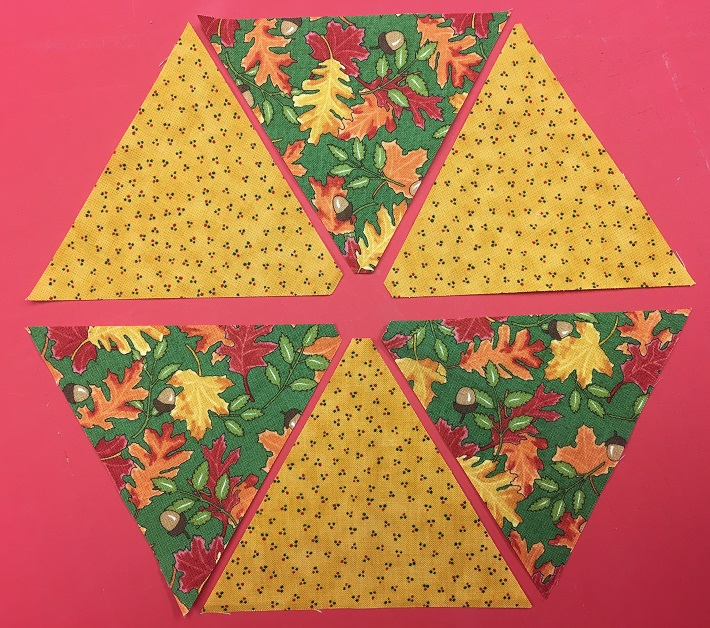 Triangle arrangement for a fabric hexagon
