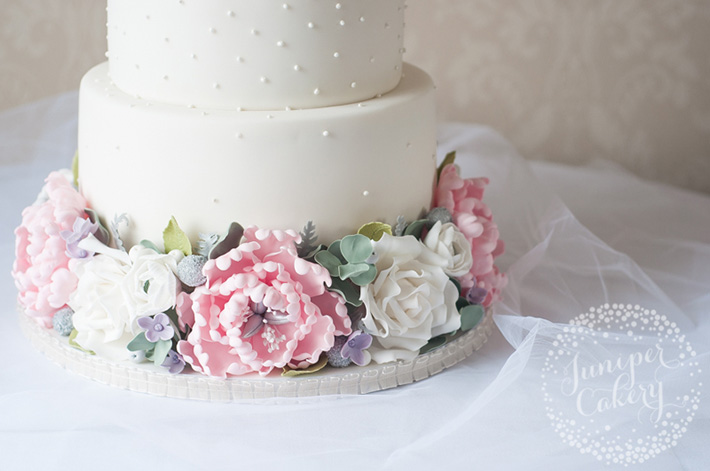 Floral cake with sugar eucalyptus leaves by Juniper Cakery