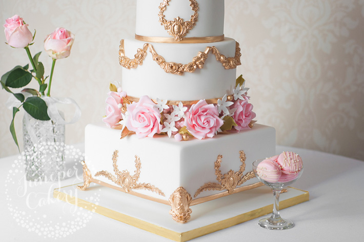 Floral separater on a wedding cake by Juniper Cakery