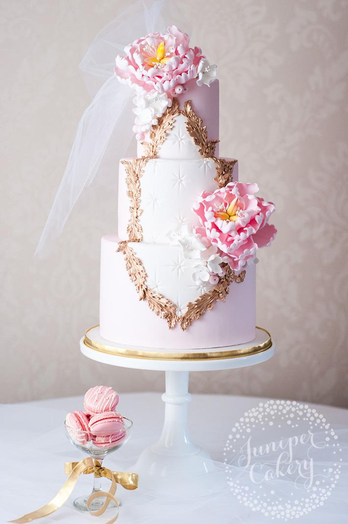 Open peonies on an orange wedding cake by Juniper Cakery