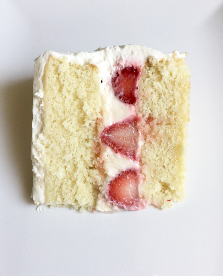 A Slice of Cake With Strawberry Cake Filling