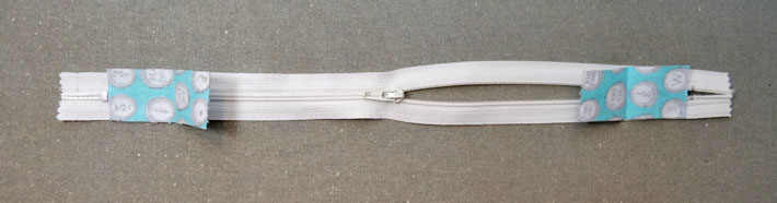 Zipper With Fabric Tabs in Place