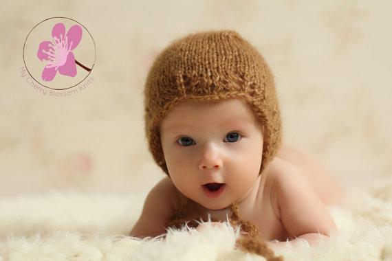 Adorable baby bonnet with lace edge