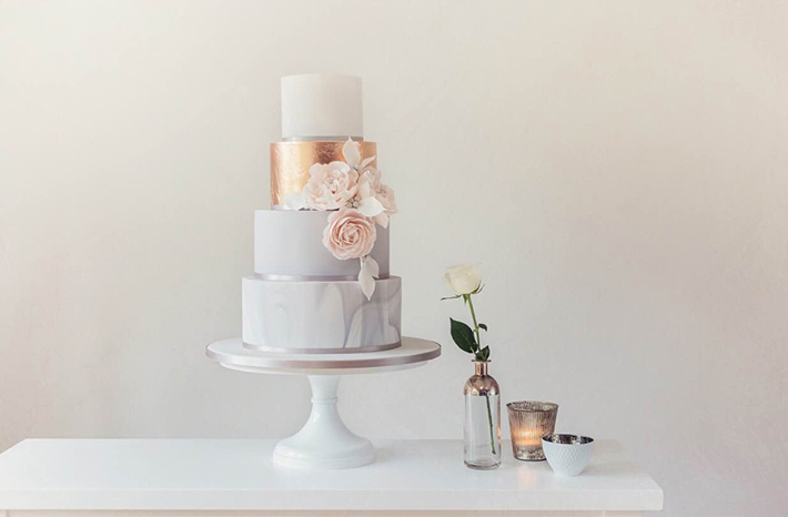 Rose gold and marble wedding cake by Poppy Pickering