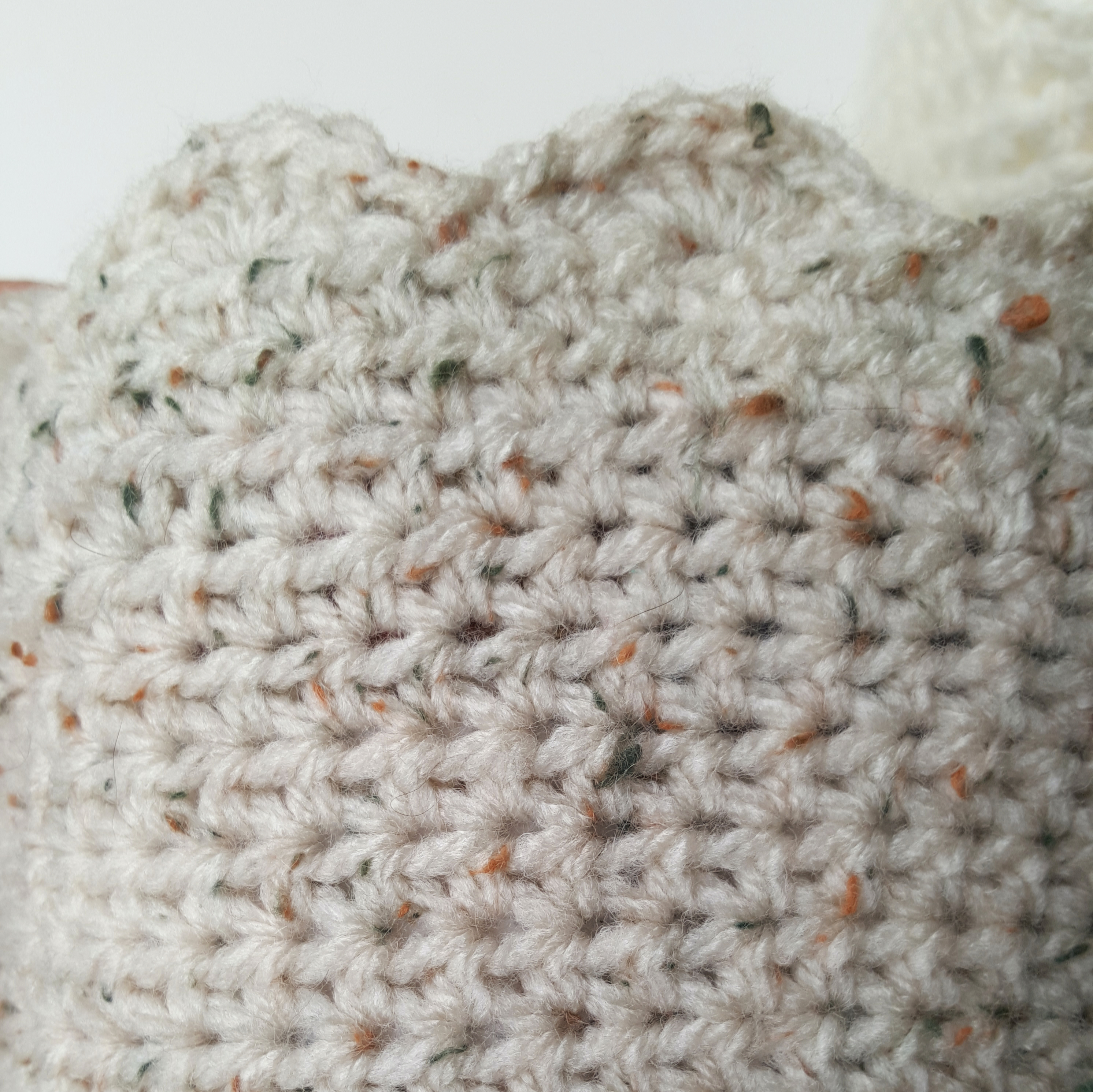 Flip a half-double crochet basket inside out to reveal the wrong side of the fabric.