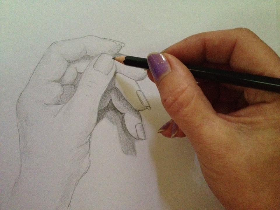 Hand drawing a hand