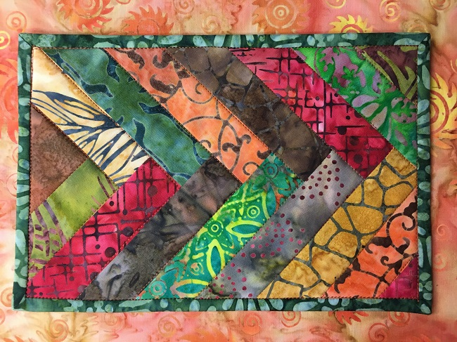 Batik Braid Mug Rug Quilted in the ditch