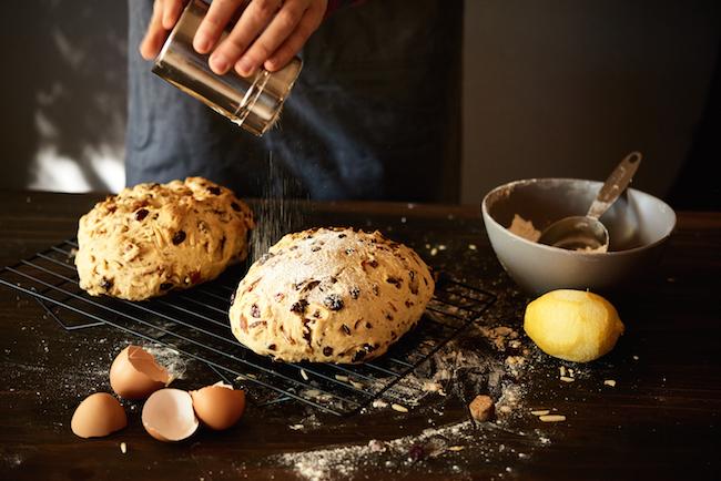 Sifting Powdered Sugar on Stollen Bread