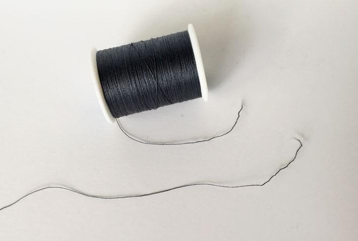 Broken Black Thread