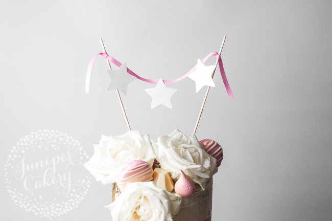 Create a bunting cake topper with ribbon