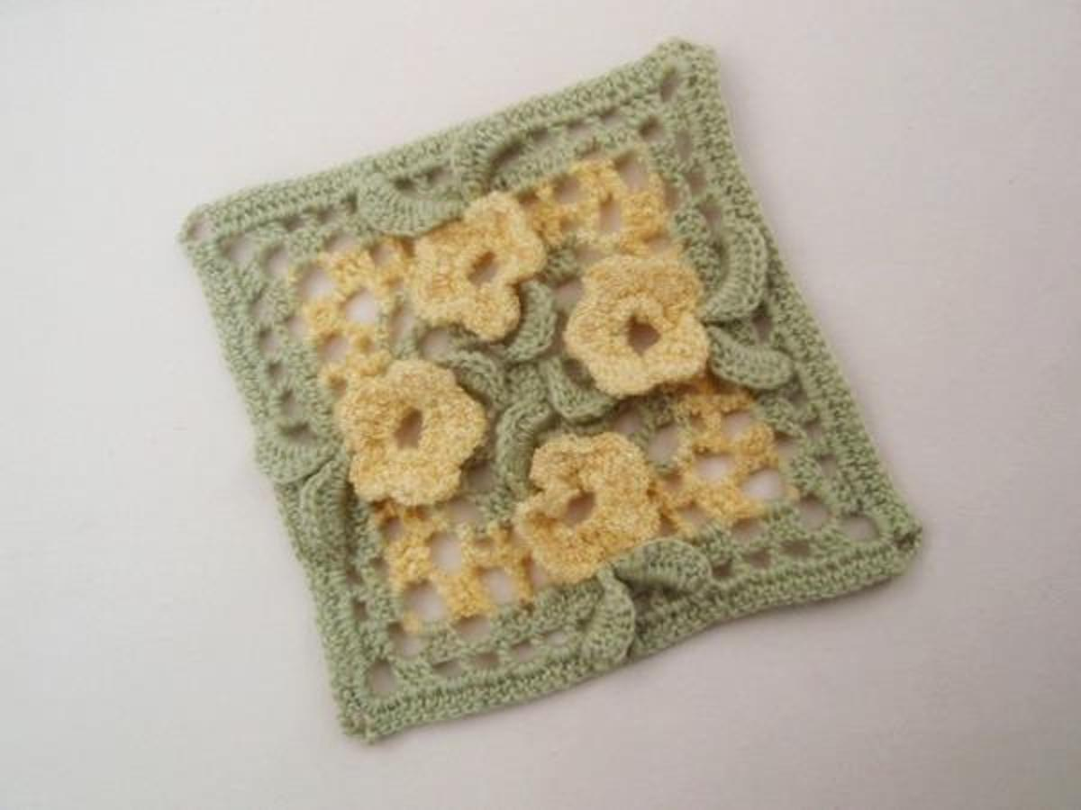 crochet granny squares with flowers and leaves