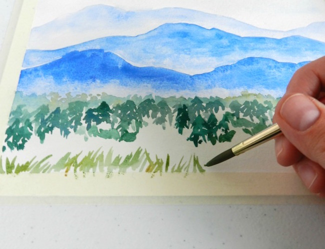 Grassy foreground in a watercolor mountains painting
