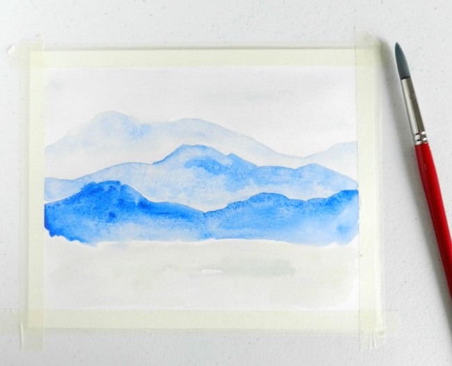 Add the foreground of your watercolor mountain painting
