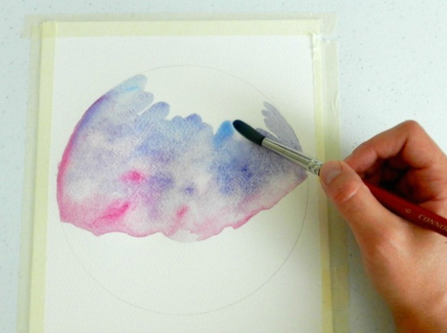 Start by adding a watercolor wash to paint your starry night sky