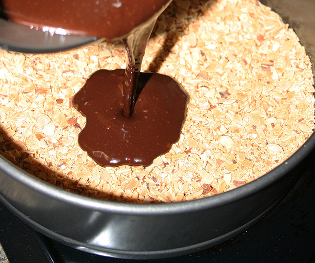 Pour the chocolate ganache into the almond shell