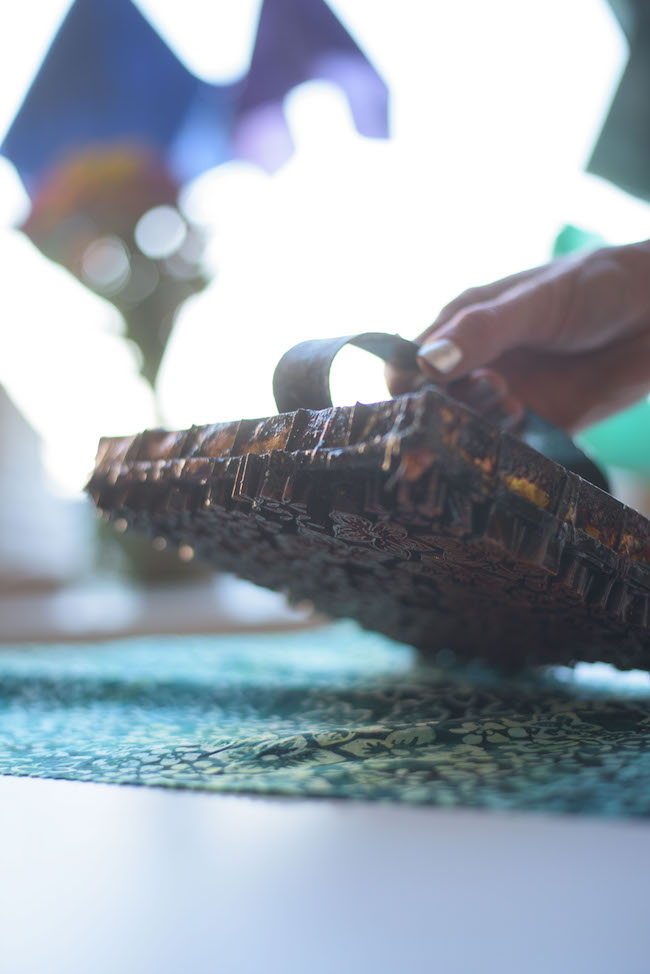 Pressing Batik Chop on Fabric