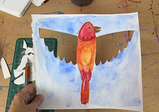 watercolor bird painting with the wings cut out