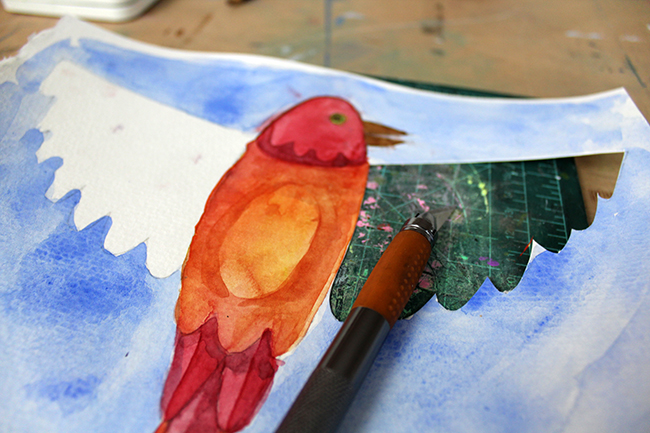 bird painting with half of the wing cut out