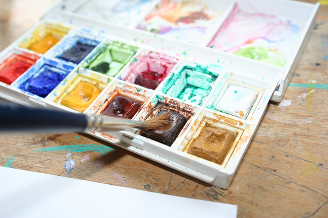 Dab of brown watercolor paint