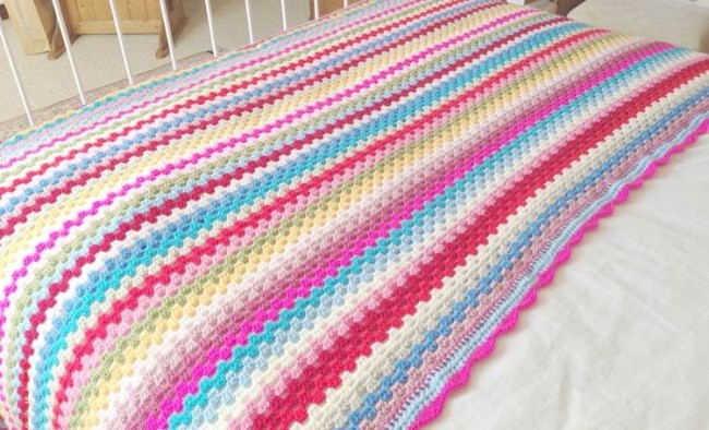 Granny stripe blanket as a bed cover