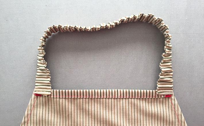sew on elastic neckband to apron inside