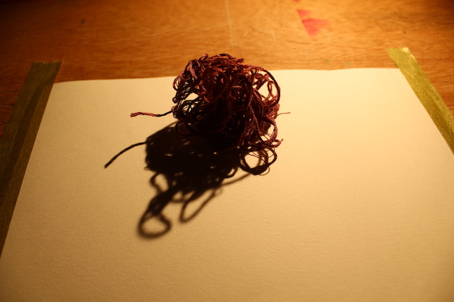 ball of thread with an exaggerated shadow