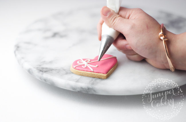 How to hold a piping bag with royal icing