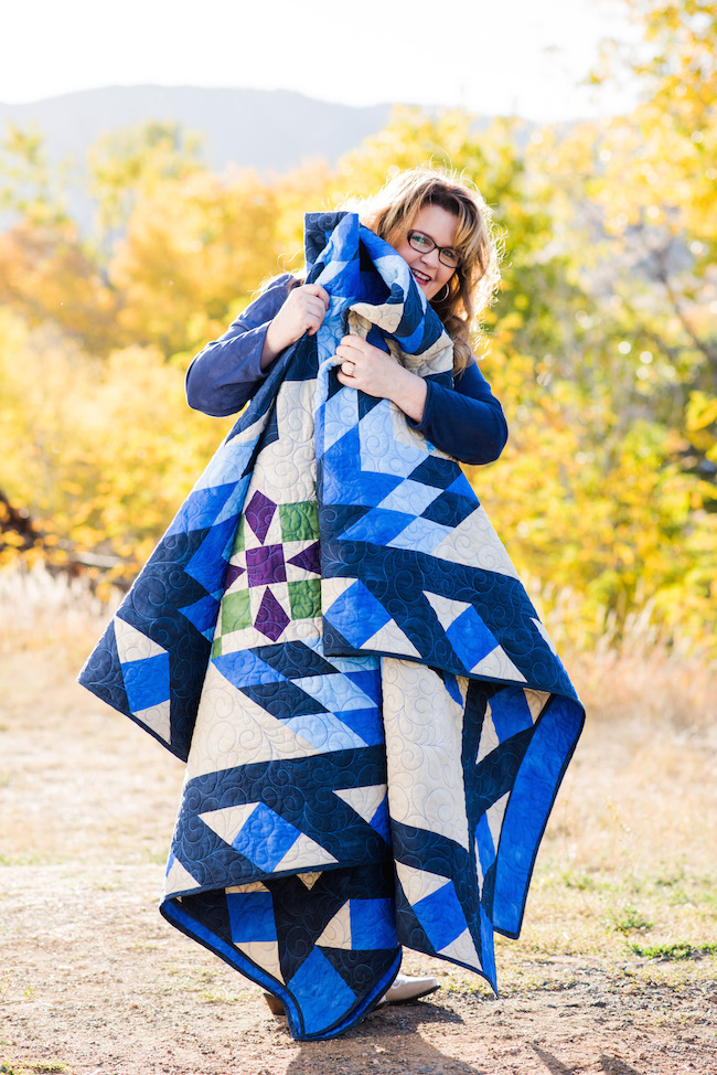 Nancy McNally Holding her Blazing Star Quilt