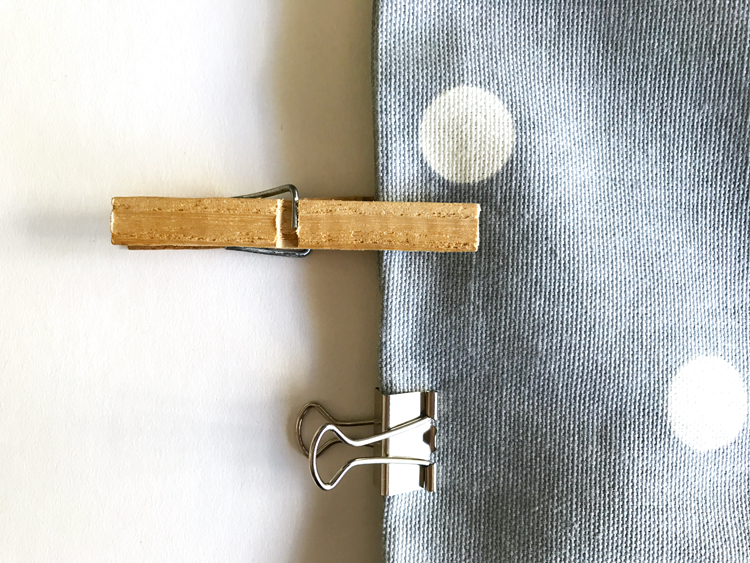Clothespins and Binder Clip on Fabric