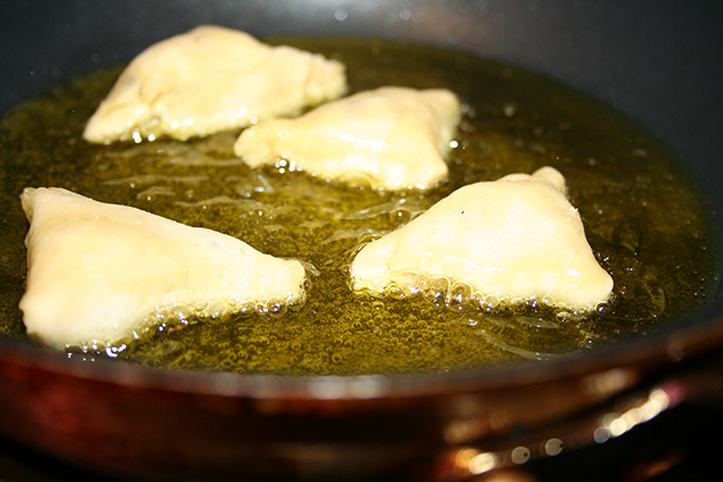 Frying samosas