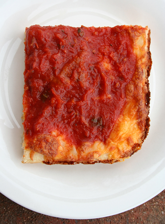 Detroit pizza slice