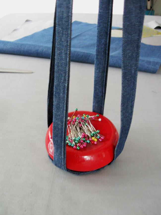 red pincushion showing plant hanger straps