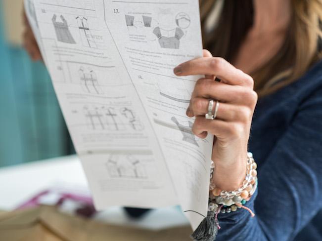 Woman reading sewing pattern