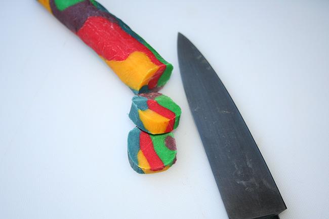 Rainbow cookies being sliced