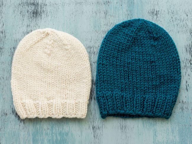 Cream Knit hat next to blue knit hat
