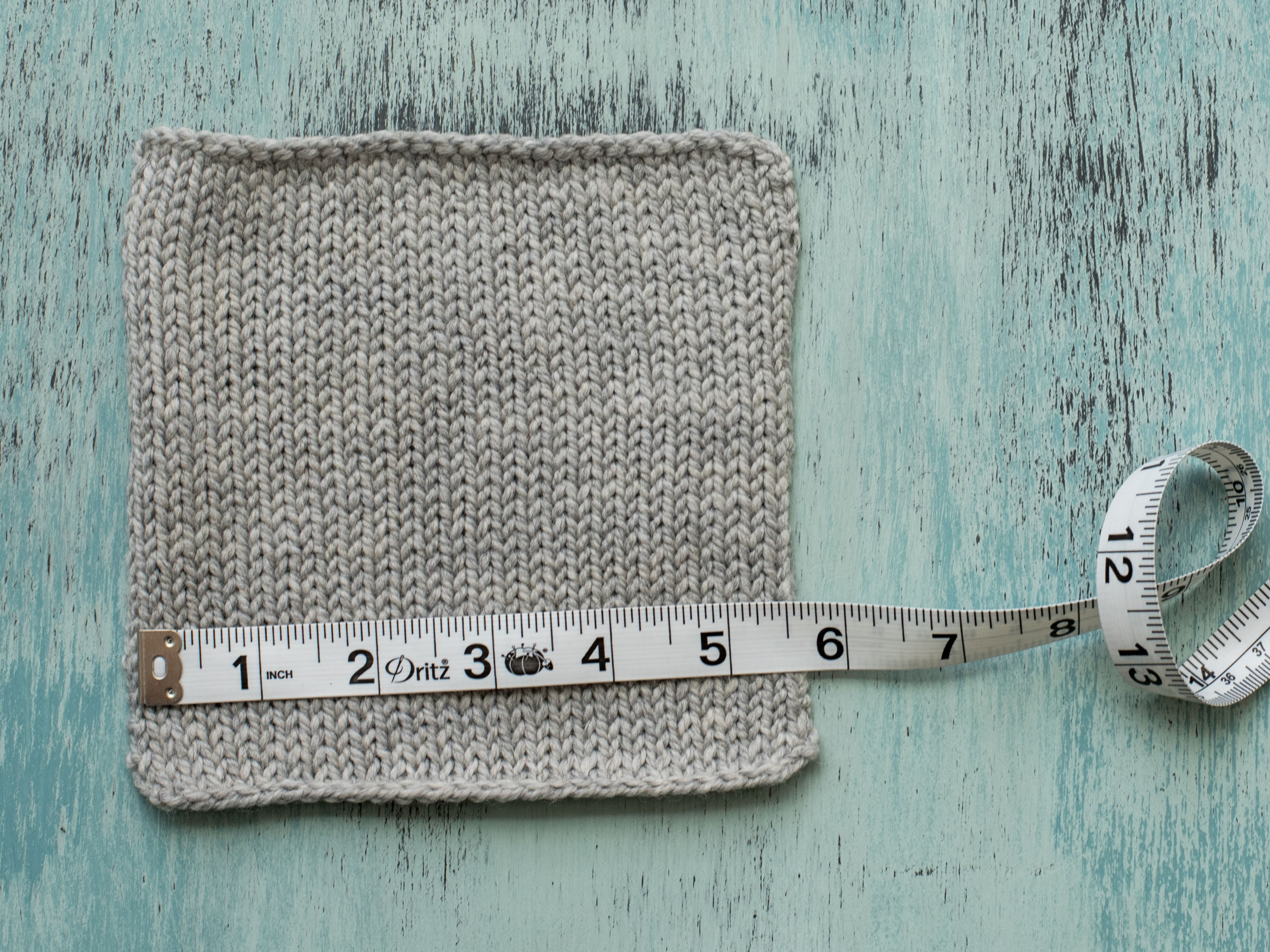 Measuring Stitch Gauge on Knit Gray Swatch